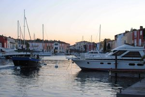 The artificial port of Port Grimaud is home to many tourists, boating companies and markets. There is a reason it is called Little Venice. I believe it.
