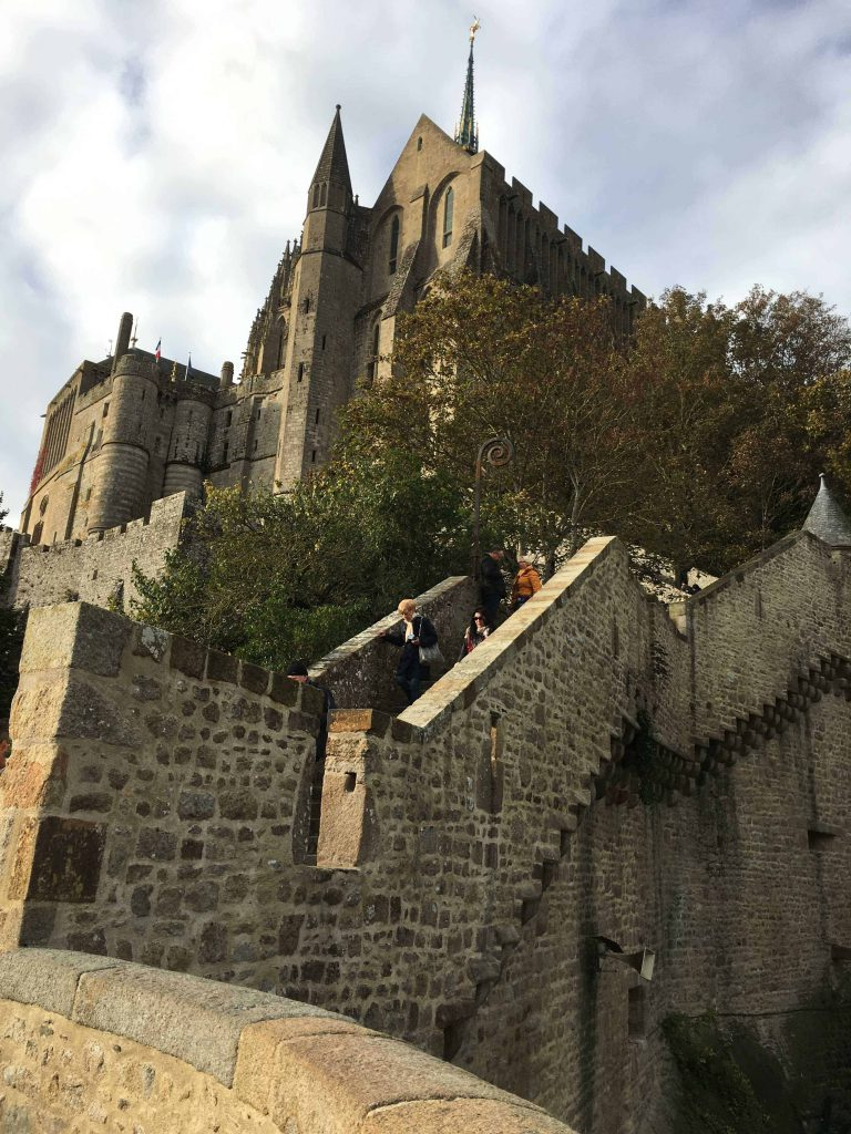 Hiking up the famous Mont St Michel takes a lot of forethought, and fortitude. We managed to do it all on the most unlikely of days and witnessed a surprise